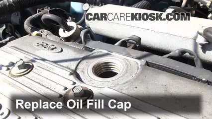 5  replace cap put the oil fill cap back on the engine