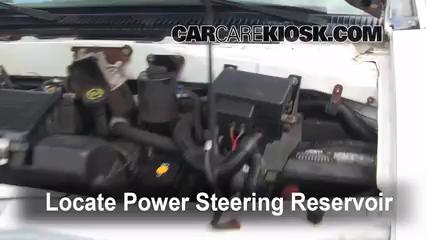 locate the power steering fluid reservoir