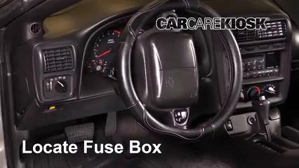 locate interior fuse box and remove cover  3