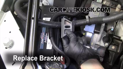 replace the bracket to secure the new battery