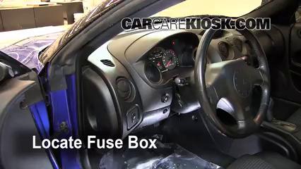 2  remove cover locate interior fuse box and remove cover