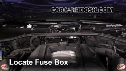 replace a fuse 2004 2010 volkswagen touareg 2006 volkswagen  locate engine fuse box and remove cover