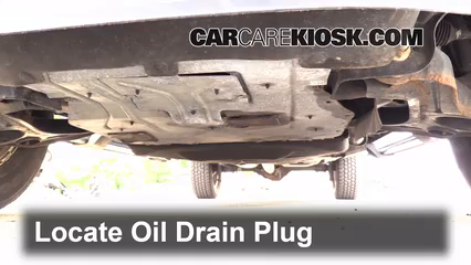 Locate The Oil Drain Plug Underneath The Vehicle