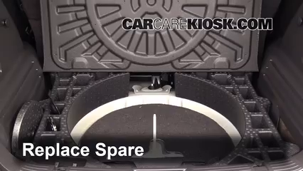 Replace Spare Put The Spare Tire Back In Place