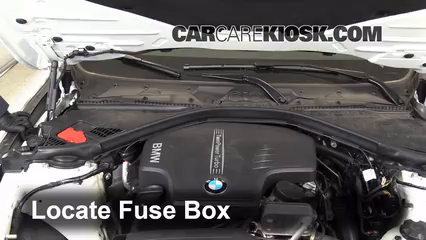 locate engine fuse box and remove cover