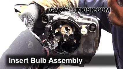 2014 vw jetta headlight assembly removal