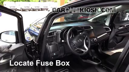 locate interior fuse box and remove cover