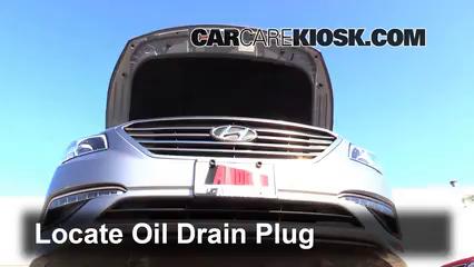 Locate The Oil Drain Plug Underneath The Vehicle