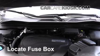 locate engine fuse box and remove cover